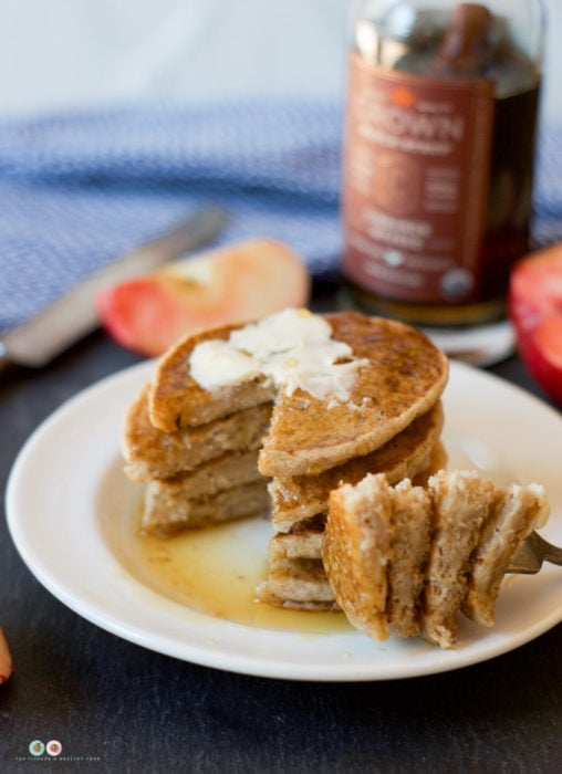 Craving some apple recipes this fall? Make some easy and quick Gluten Free Apple Cider Pancakes for breakfast, they're nut-free and vegan too! - @TheFitCookie #vegan #glutenfree