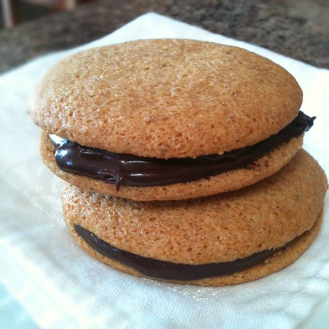 Craving sandwich cookies? Make some of these crispy Honey Sandwich Cookies that are natural and gluten free. Fill them with dairy free homemade chocolate ganache! - @TheFitCookie #glutenfree #dairyfree