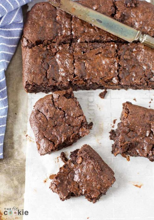 Looking for an allergy friendly brownie recipe? Make a batch of these Vegan One Bowl Fudge Brownies that are gluten free, nut free, and made with simple ingredients you probably already have in your pantry! | TheFitCookiecom #vegan #glutenfree #brownies #chocolate