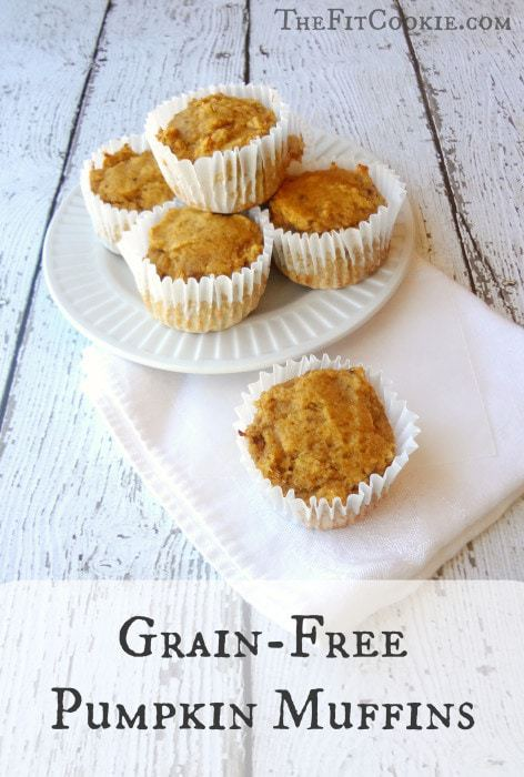 paleo pumpkin muffins on a white wood board
