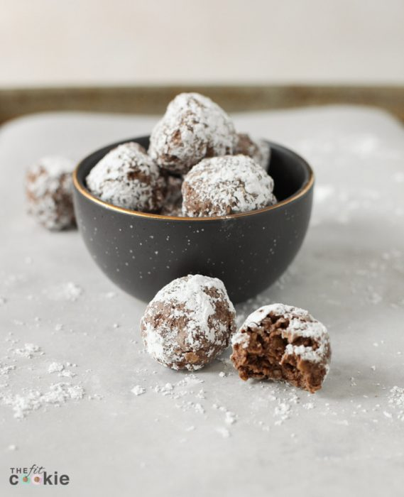 vegan chocolate no bake cookies on parchment paper and in a small gray bowl