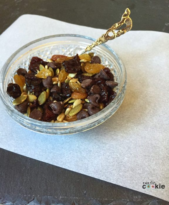 close up photo of nut free trail mix in a cut glass bowl