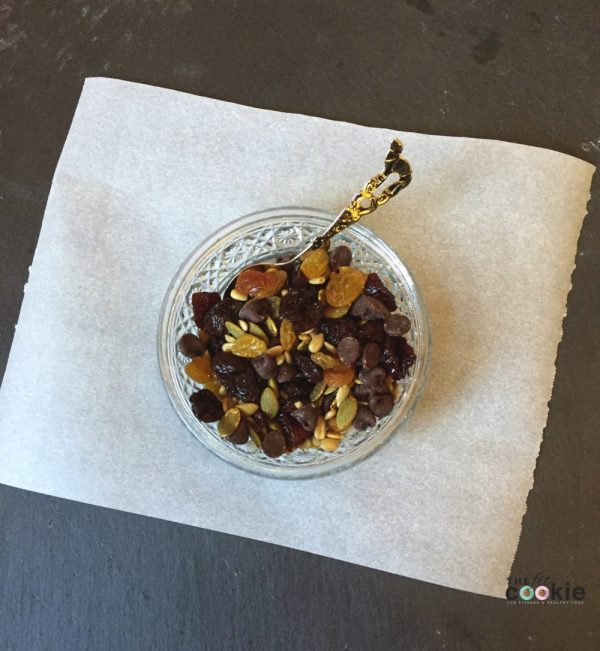 nut free trail mix in a glass bowl with mini chocolate chips