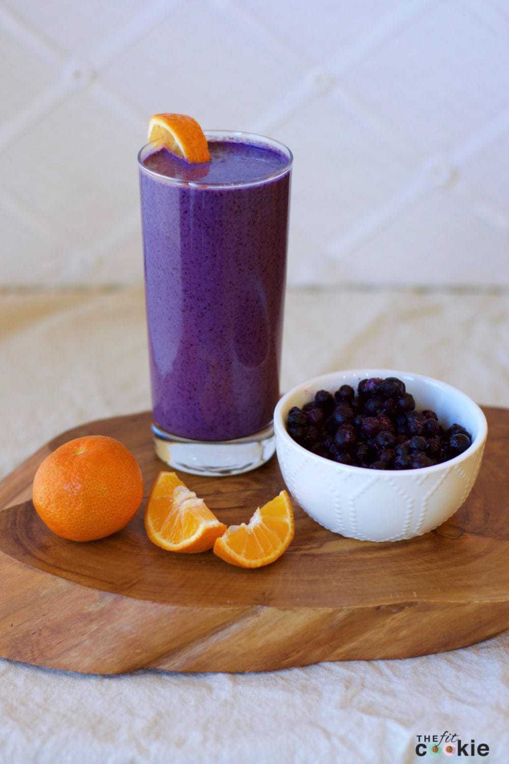 Looking for a cool and quick summer snack? Make this Creamy Blueberry Orange Smoothie - it's even great for breakfast and it's naturally paleo and vegan - @thefitcookie #recipe #vegan #glutenfree