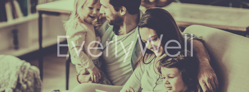 "family sitting on a couch with words ""EverlyWell"" overlaid"