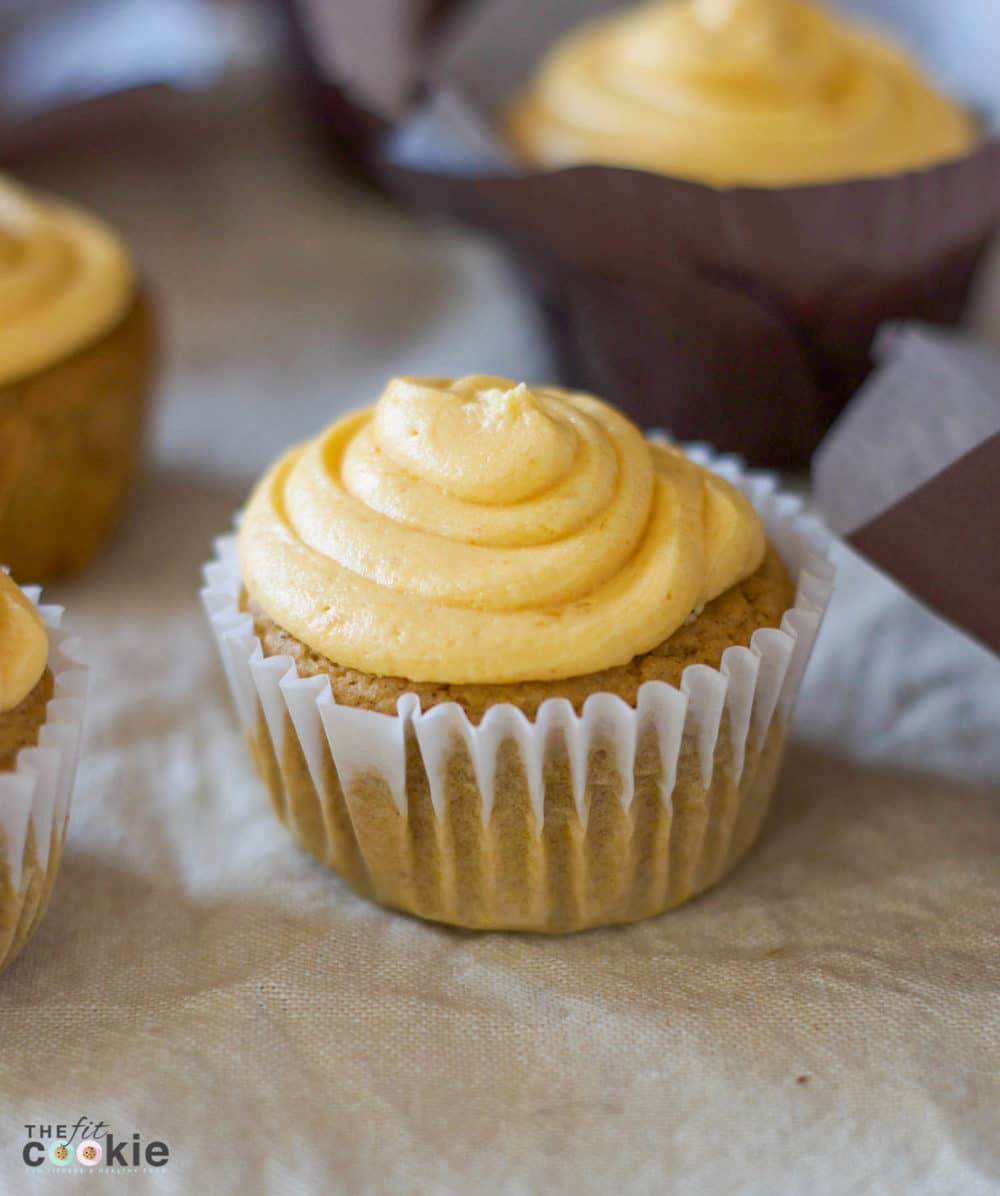 Celebrate fall with some pumpkin cupcakes! These Pumpkin Spice Cupcakes with Pumpkin Buttercream Frosting are gluten free, dairy free, vegan, and nut free. They are an easy and allergy friendly way to add pumpkin spice to your dessert menu - @TheFitCookie #glutenfree #dairyfree #vegan #pumpkin