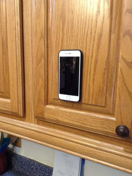 phone on the door of a cabinet - megaverse Antigravity phone case