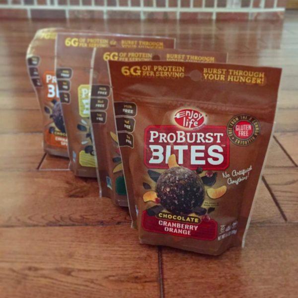 4 packages of Enjoy Life Pro Burst Bites in older packaging
