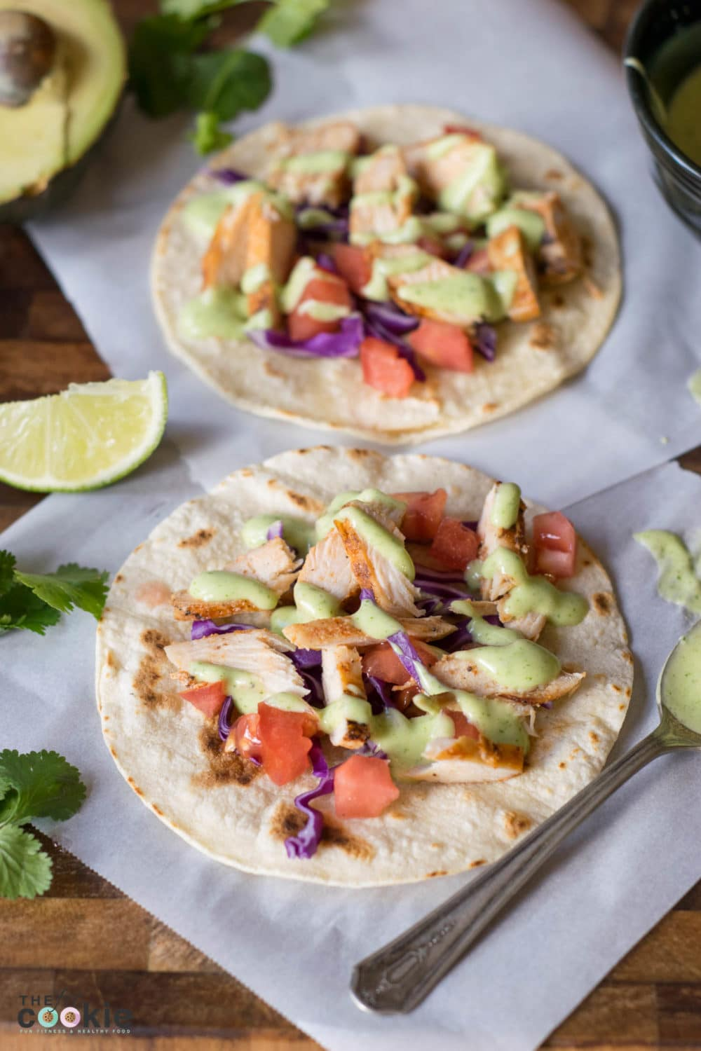 These Grilled Chicken Tacos with Cilantro Crema make a quick, healthy, and allergy-friendly weeknight meal if you use leftover grilled chicken! These are gluten-free, dairy-free, and nut-free, simple, and AMAZING! | thefitcookie.com #dairyfree #glutenfree #tacos