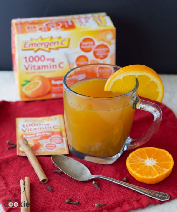 This delicious Super Orange Spiced Cider will warm you up on chilly evenings and fill your home with the wonderful smell of cinnamon and cloves! Plus, this vitamin drink is gluten free and full of vitamins and minerals for immune support - #AD @TheFitCookie #FallImmuneSupport #glutenfree