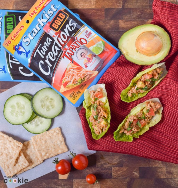 Spice up your lunchtime meals with these Spicy Tuna Lettuce Cups made with StarKist Tuna Creations BOLD Tapatío. These are gluten free, soy free, and nut free, so everyone can dig in! - #AD @TheFitCookie #TearEatGo | Tuna salad in lettuce cups with avocado, tomatoes and crackers