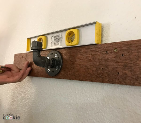 Looking for a fun home project you can tackle in a day or 2? See how we made a couple sets of rustic industrial wall hooks for our home! - @TheFitCookie #home #DIY #crafts