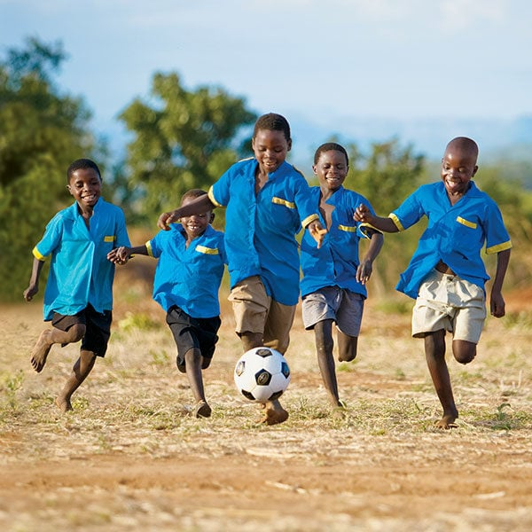 Working on getting ideas for Christmas gifts? Check out the World Vision Gift Catalog for gifts that share hope for the holidays and give back to those in need! - #AD @TheFitCookie #WVGiftCatalog #charity | Kids playing soccer