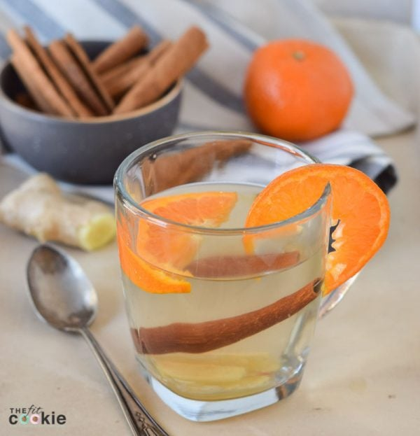 Support your immune system this winter with this delicious and super easy Ginger Orange Wellness Tea that you can make with whole, simple ingredients in less than 15 minutes - @TheFitCookie #health #paleo #vegan