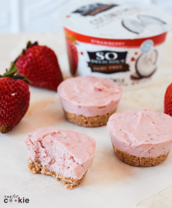 These delicious Mini Dairy Free Strawberry Cheesecakes are the perfect gluten free and vegan cheesecake: easy to make, perfect portion sizes, fresh strawberry taste, and no artificial flavors or colors! - @TheFitCookie #AD #dairyfree #glutenfree #SoDelicious #SoDeliciousYogurt #NothingCompares