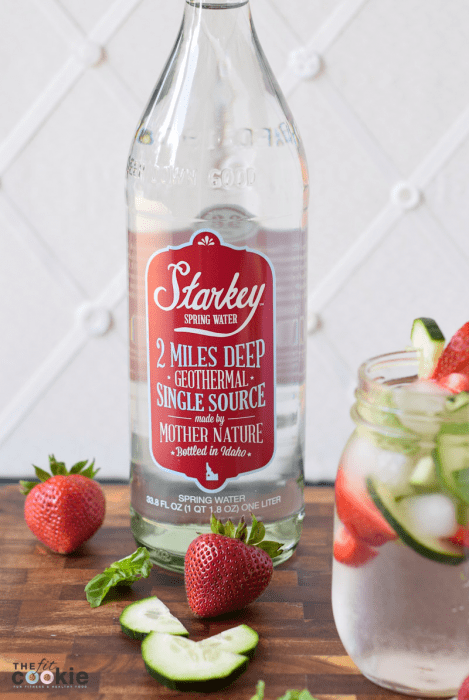 bottle of Starkey spring water next to fruit infused water in a jar