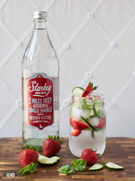 jar of fruit infused water next to a glass bottle of Starkey water