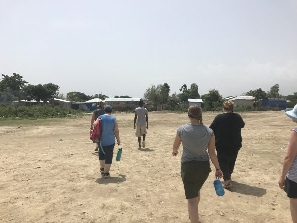 group of people walking in Bercy Haiti  to homes