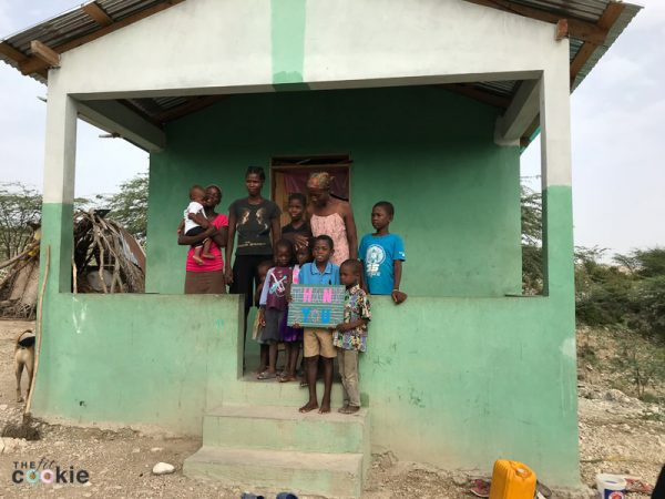 Haitian family in a new concrete block home built with funds raised through The Mission Haiti