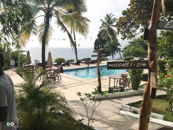 view of the swimming pool and ocean at Wahoo Bay resort in Haiti