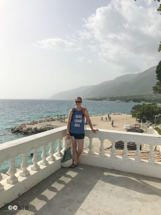 photo of me standing on a balcony overlooking the ocean in Haiti at Wahoo Bay resort