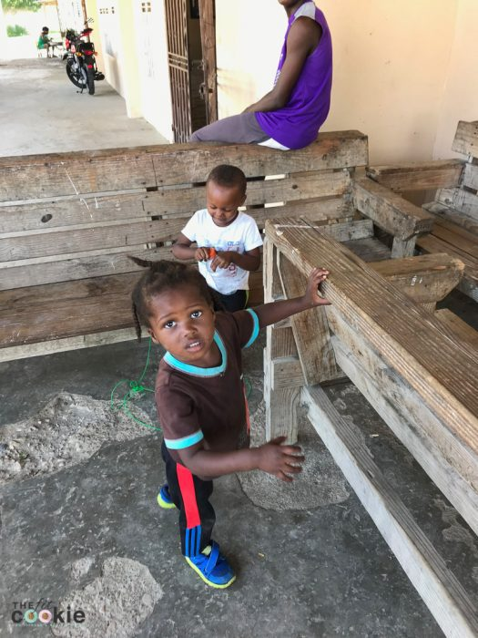 two small boys by a bench at the Cabaret Children's Home in Haiti