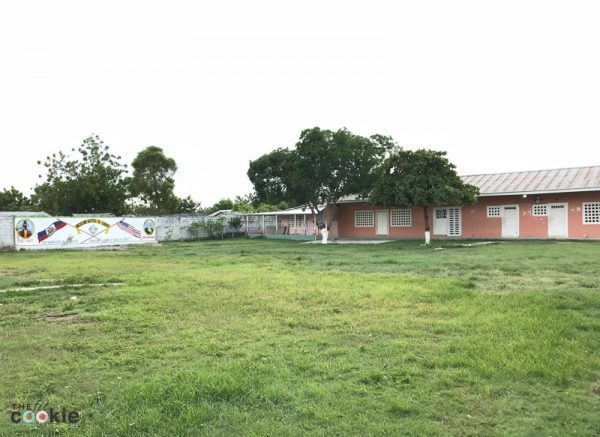 Cabaret children's academy school yard surrounded by wall