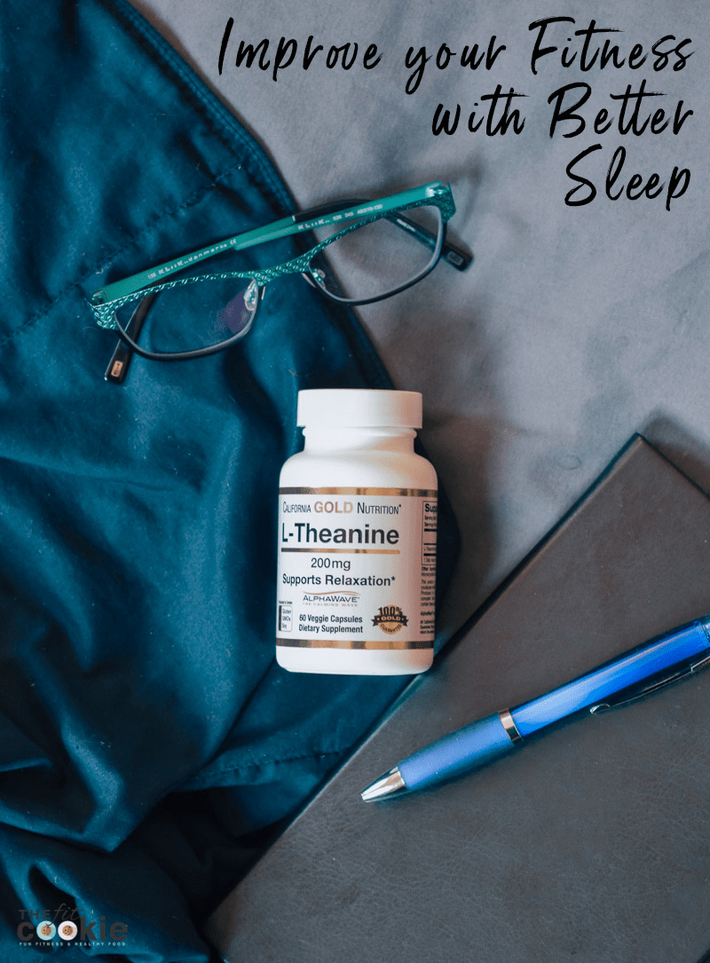 glasses, pen, notebook, and supplement bottle on a bed with blankets