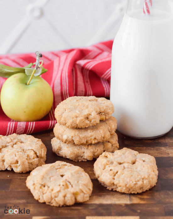 gluten free apple oatmeal cookies next to a bottle of dairy free milk