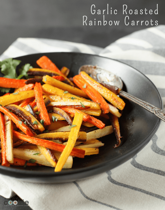 garlic roasted rainbow carrots in a black dish on a napkin