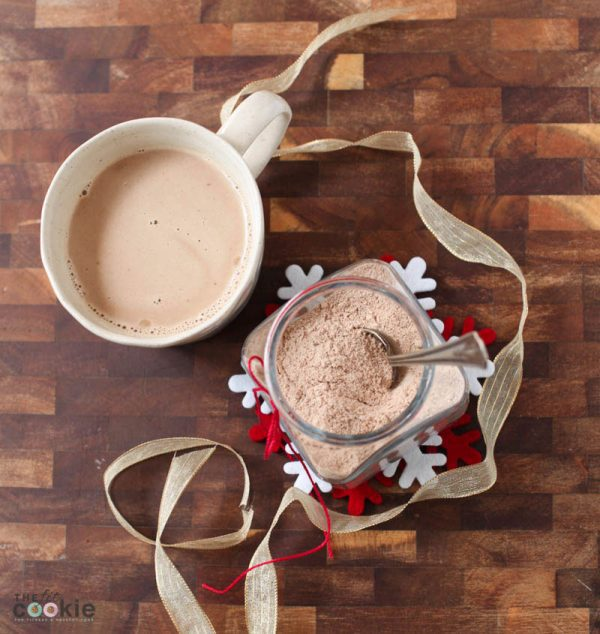 overhead photo of mug with cappuccino next to a jar filled with dairy free vegan cappuccino mix