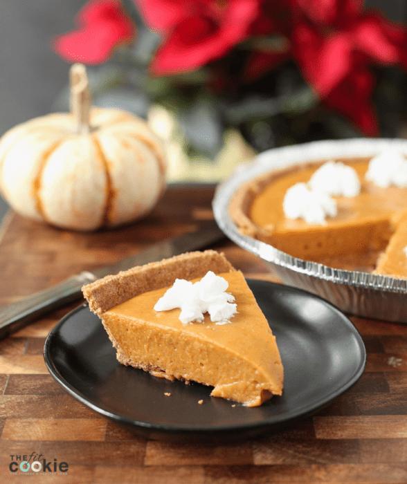 slice of dairy free no bake pumpkin pie on a black plate