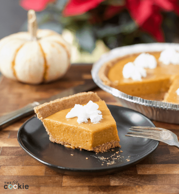 slice of no bake dairy free pumpkin pie on a plate with whipped cream on top