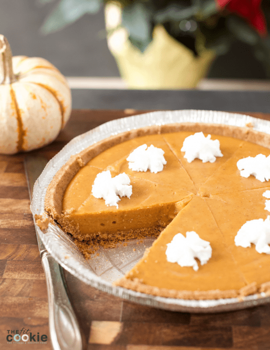 full dairy free no bake pumpkin pie on a pie plate with a slice removed