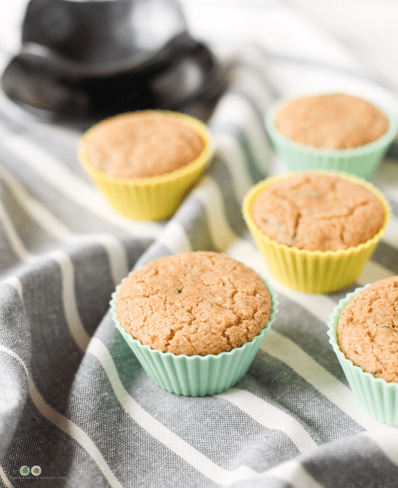 nut free vegan zucchini muffins in silicone muffin liners on a napkin