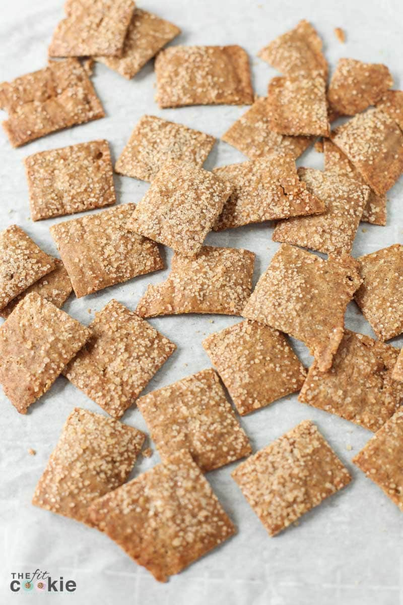 vegan gluten free cinnamon sugar crackers scattered on parchment paper