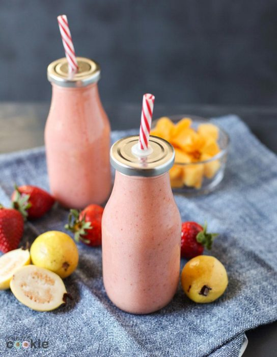 dairy free strawberry guava smoothie in glass bottles