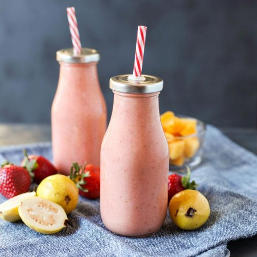 Brighten up your winter day with this delicious tropical Strawberry Guava Smoothie, it's paleo, vegan, and has no added sugars - @TheFitCookie #paleo #vegan #smoothie