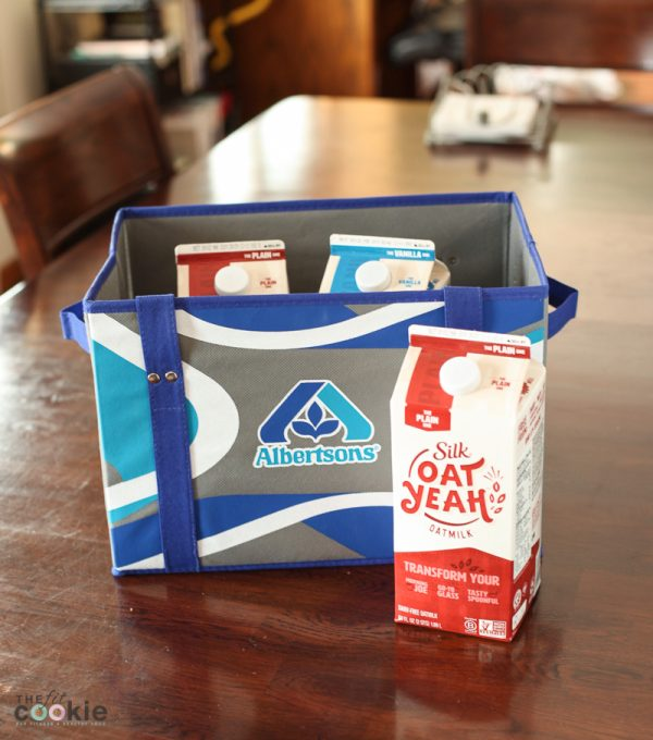 Silk Oat Yeah cartons in an Albertsons shopping bag on a table