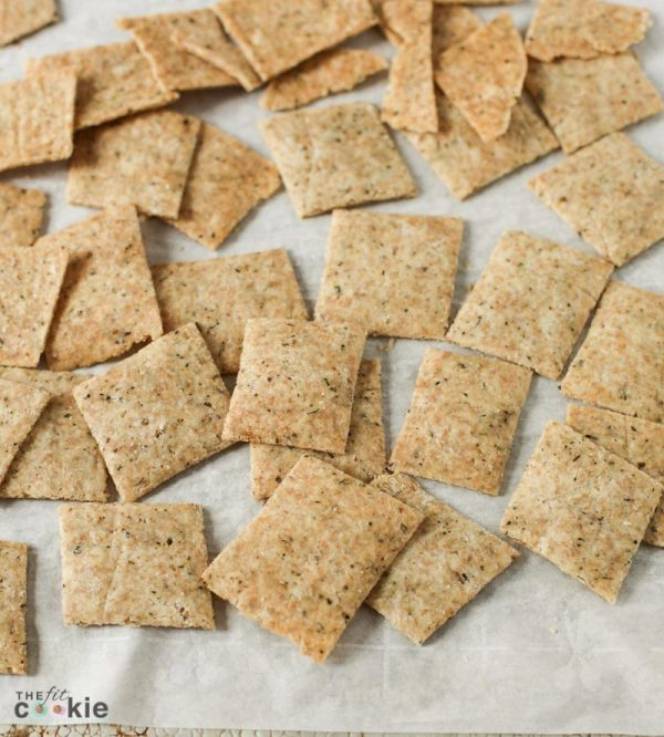 gluten free garlic herb crackers scattered on parchment paper