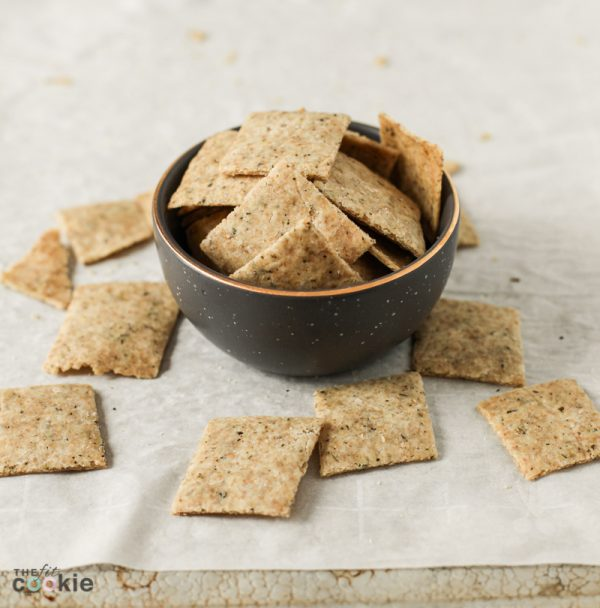 small gray bowl of gluten free herb crackers
