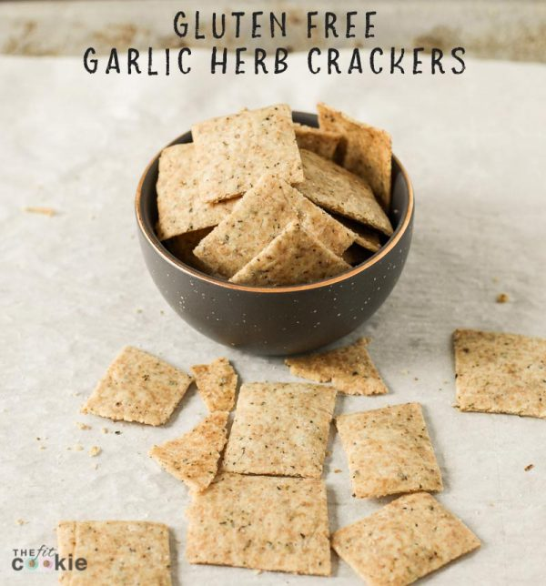 small gray bowl filled with vegan garlic herb crackers