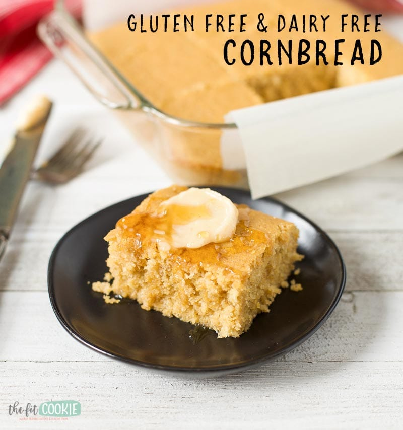 slice of gluten free cornbread topped with dairy free butter and drizzle of honey