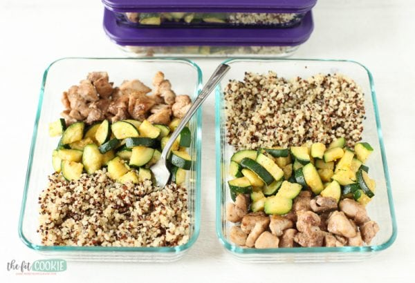 glass meal prep bowls filled with Jamaican jerk chicken and quinoa