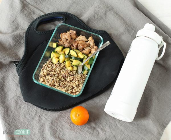 jamaican jerk chicken meal prep bowl with white water bottle and lunch bag