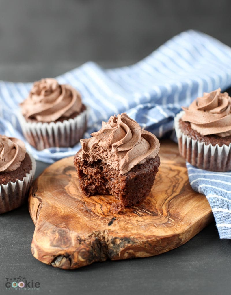 vegan chocolate cupcake with chocolate buttercream with a bite taken