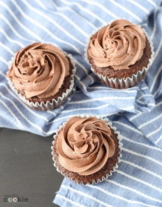 overhead photo of gluten free chocolate cupcakes on a blue napkin