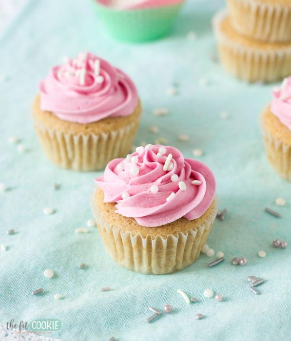gluten free vegan cupcake with pink frosting on a teal napkin