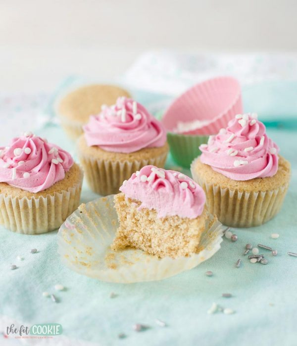 photo of vegan gluten free cupcakes topped with pink frosting and cup in half