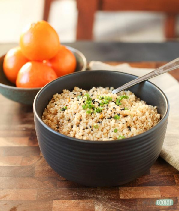 vegan sesame orange pressure cooker quinoa on a wood board